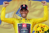 ** FILE ** Spanish rider Oscar Pereiro is seen celebrating on the podium in this July 15, 2006 file photo during the Tour de France cycling race in Montelimar, southern France. Pereiro, who came second to U.S. rider Floyd Landis in the 2006 Tour de France now stands to inherit the title after tests showed the American champion used synthetic testosterone to fuel his spectacular comeback victory. Floyd Landis of the U.S. lost his expensive and explosive doping case Thursday Sept. 20, 2007 when the arbitrators upheld the results of a test that showed the 2006 Tour de France champion used synthetic testosterone to fuel his spectacular comeback victory, The Associated Press has learned. (AP Photo/Alessandro Trovati)